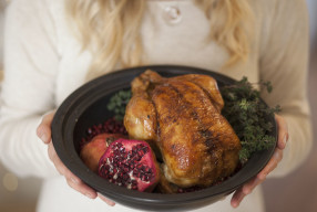 Oven roasted organic Chicken with garden stuffing served with pomegranate seeds
